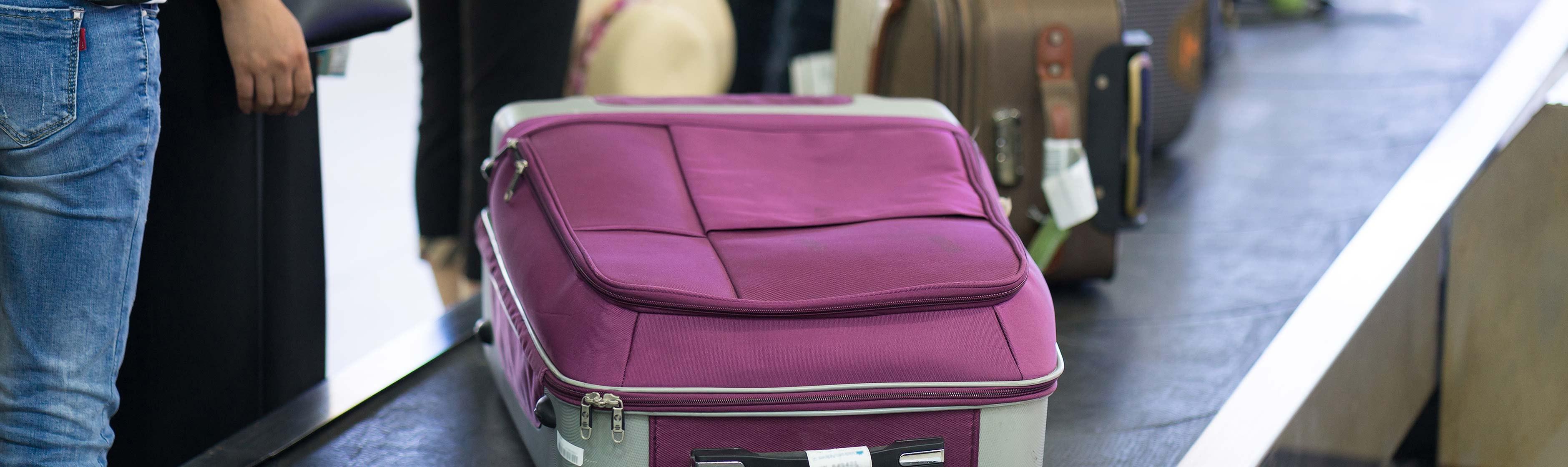 Koffer op bagageband